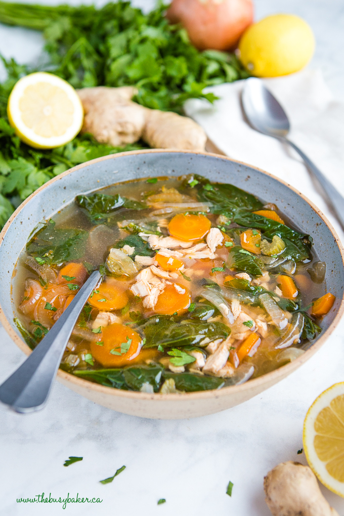 Crock Pot Lemon Ginger Chicken Soup in blue bowl with spoon