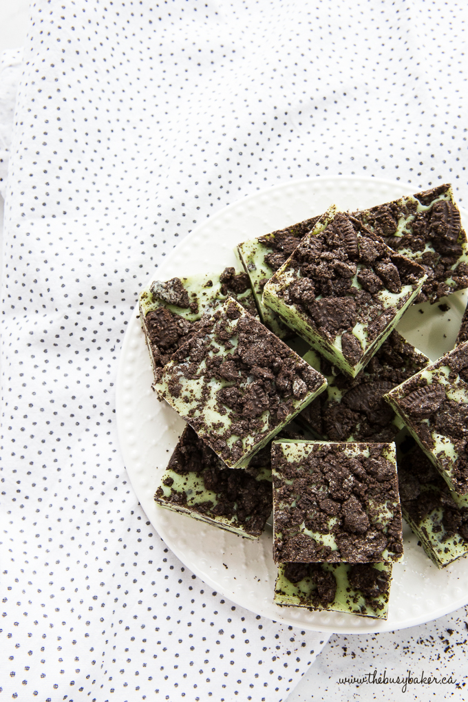 Mint Oreo Fudge on white plate with Oreo crumbs