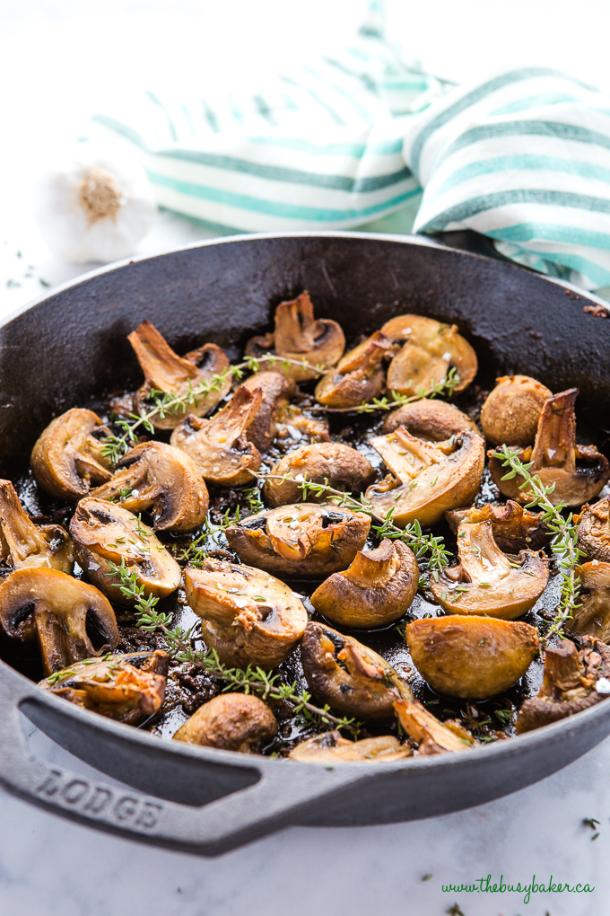 Garlic Butter Roasted Mushrooms in cast iron skillet with thyme