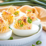 Best Ever Cheddar Bacon Ranch Deviled Eggs