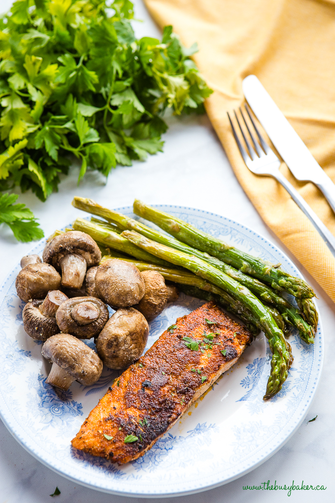 Easy One Pan Cajun Salmon with mushrooms and asparagus on Burleigh blue plate