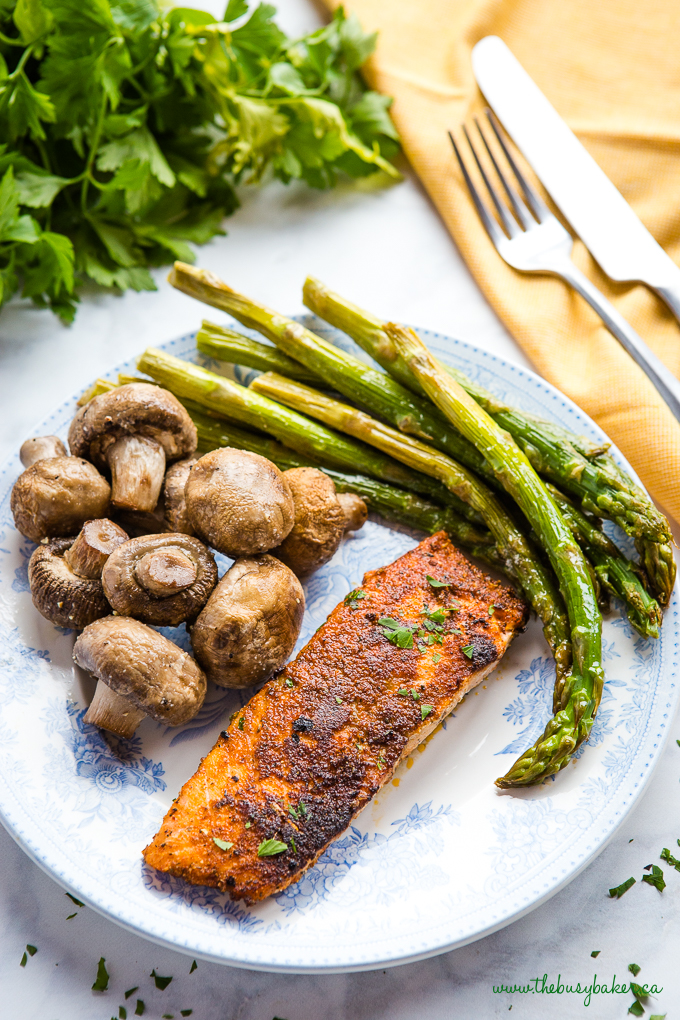 Easy One Pan Cajun Salmon with mushrooms and asparagus on blue plate