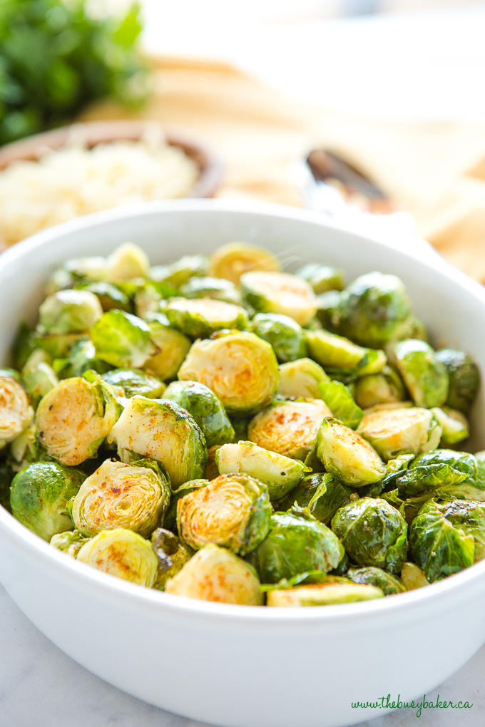 Easy Oven Roasted Brussels Sprouts in white casserole dish