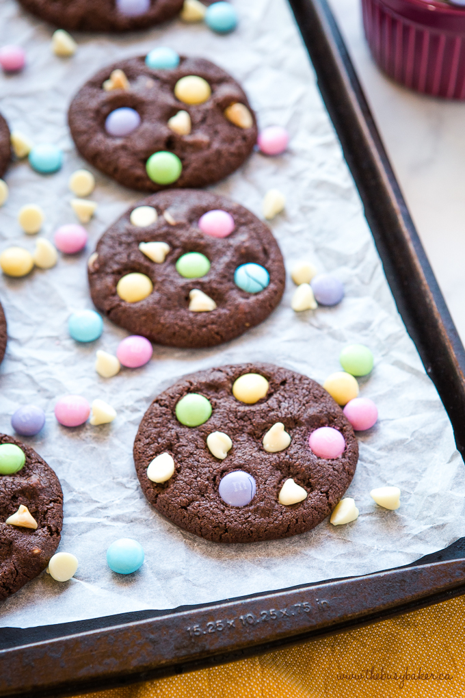 Easter Double Chocolate Cookies with Spring M&Ms on baking sheet