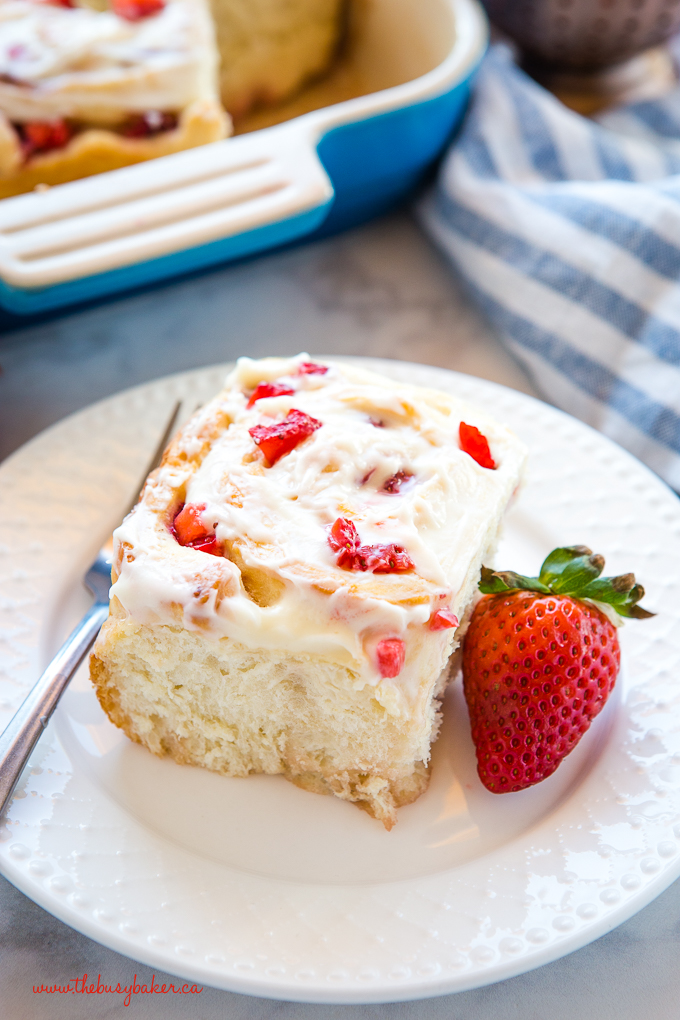 Strawberry Cheesecake Sweet Rolls on white plate with fork