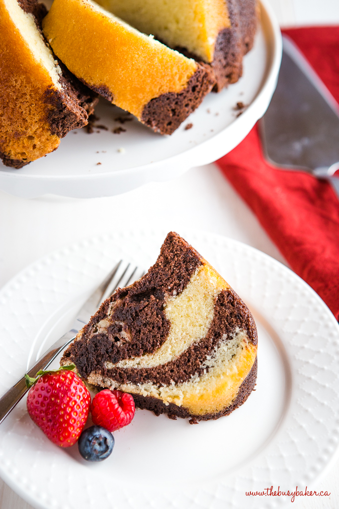 Chocolate Vanilla Marble Cake slice on white plate with fruit