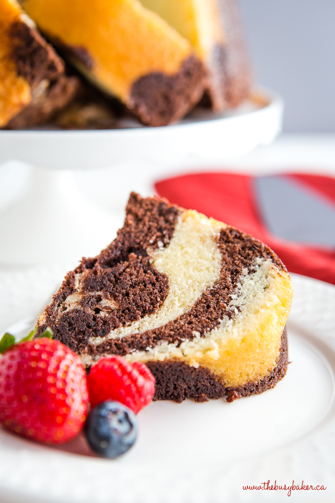 Chocolate Vanilla Marble Cake slice with fresh berries on white plate
