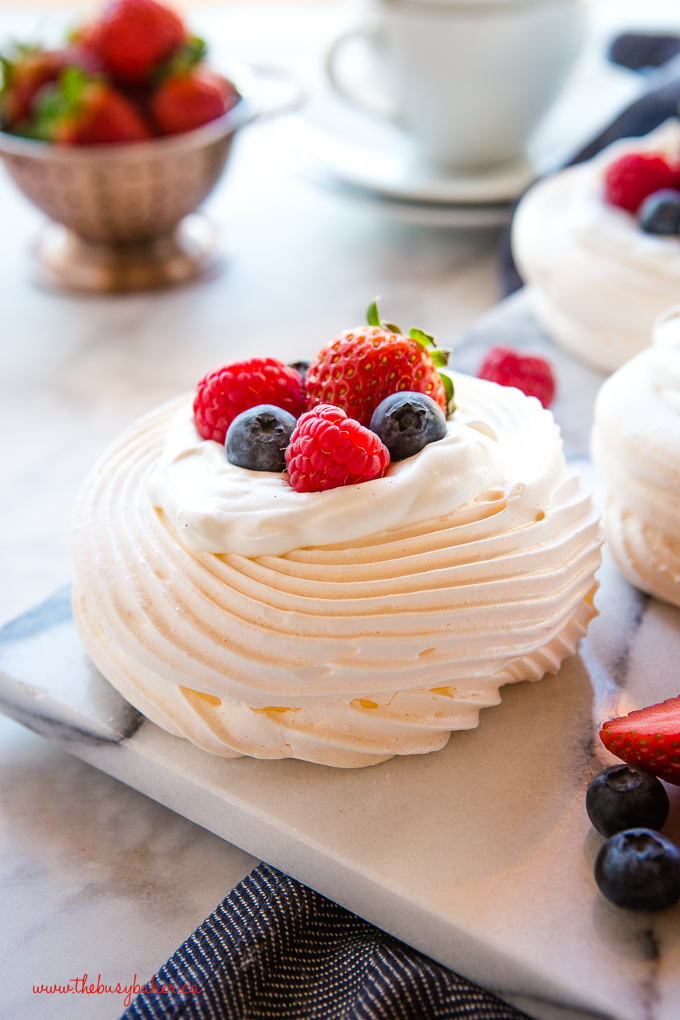 Meringue nests dessert with berries and whipped cream