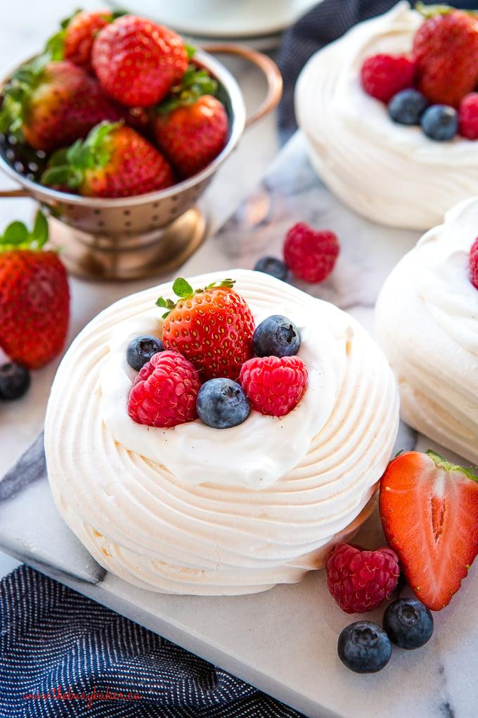 Homemade Meringue nests dessert with berries