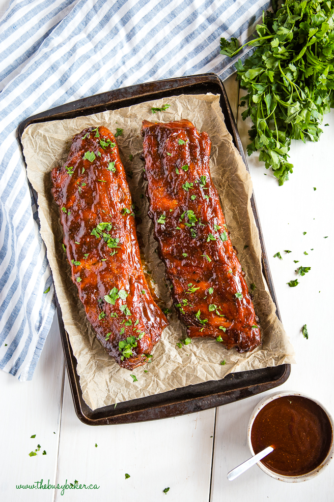 Honey Garlic ribs on sheet pan with fresh herbs