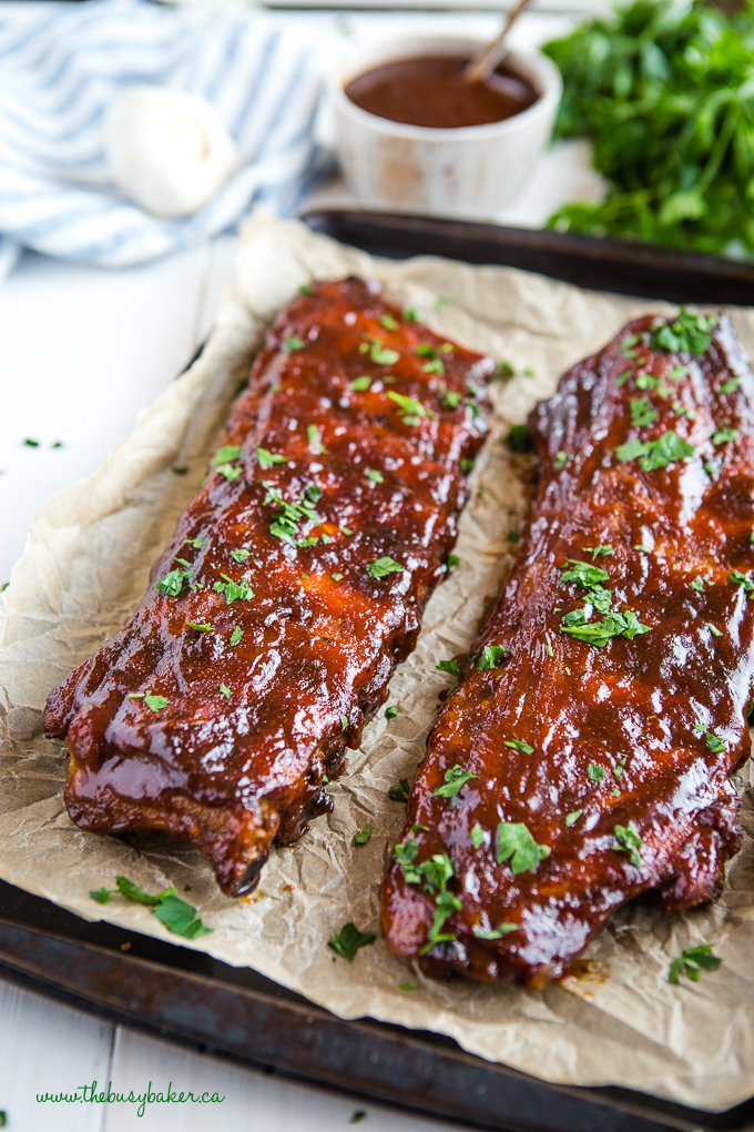 Ribs on sheet pan with barbecue sauce