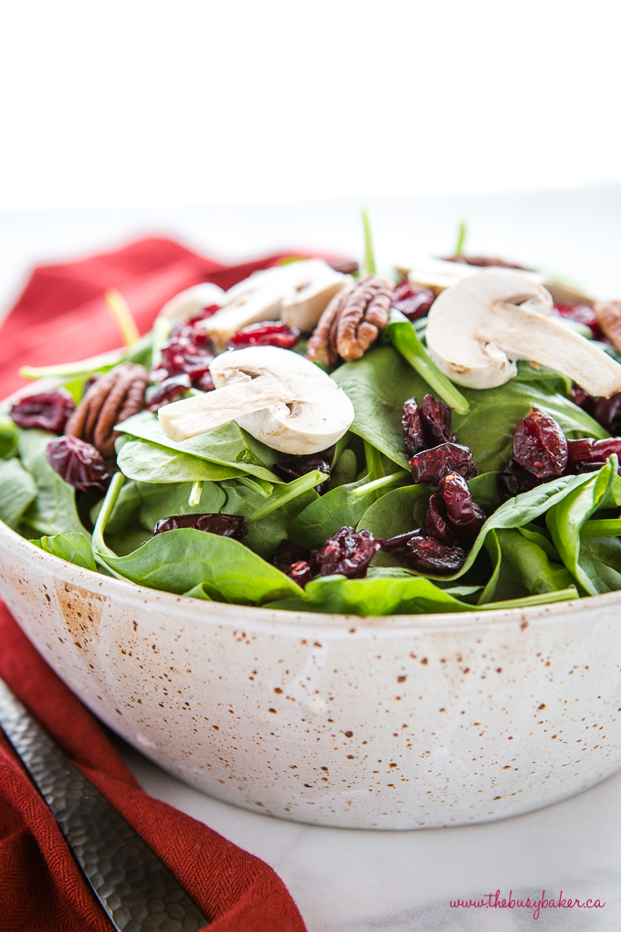 spinach salad in pottery bowl