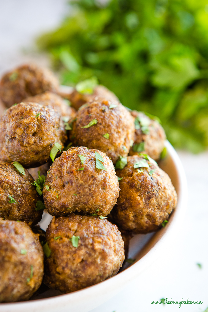 meatballs in bowl with herbs