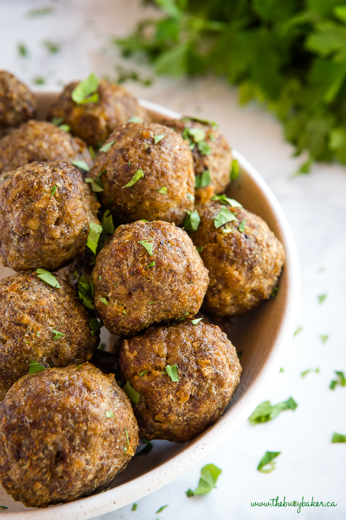 meatballs in bowl with green herbs