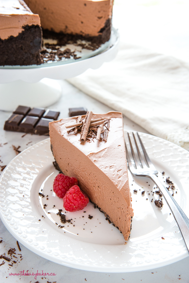 no bake chocolate cheesecake on white plate with raspberries