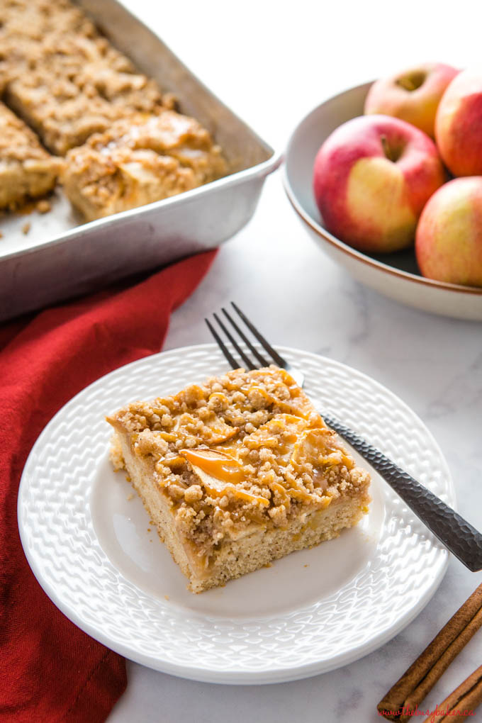 Caramel Apple Streusel Cake on white plate with black matte fork