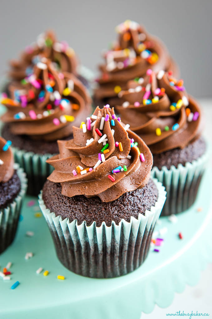 chocolate cupcake recipe made from scratch - 3 cupcakes with sprinkles and swirls of chocolate frosting