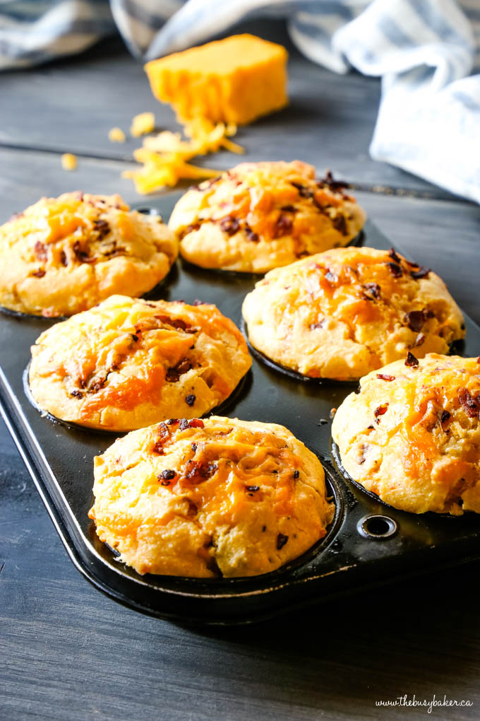 cornbread muffins with cheese in muffin tin