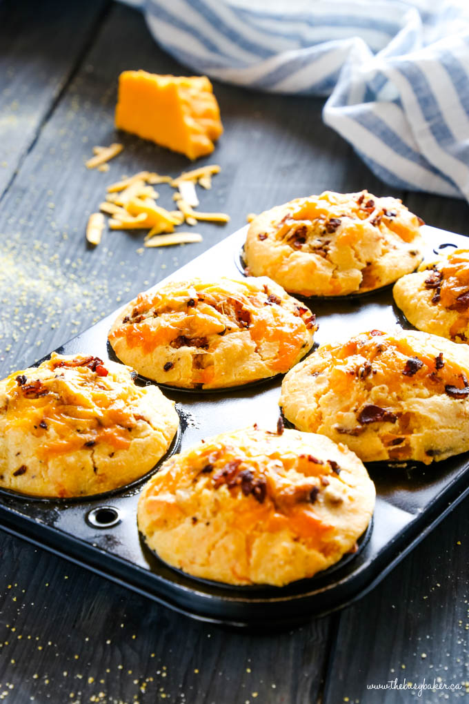 cornbread muffins in muffin tin with cheese