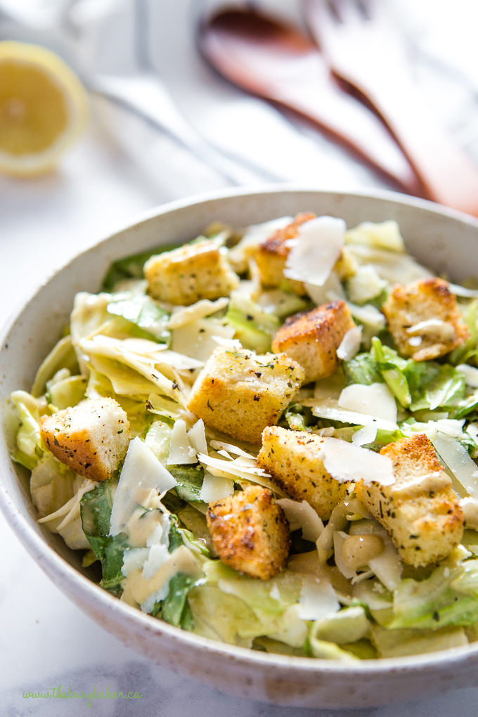 simple Caesar Salad in bowl with homemade croutons