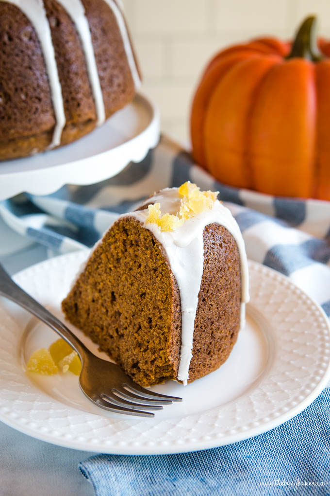 Easy Pumpkin Bundt Cake on white plate with glaze