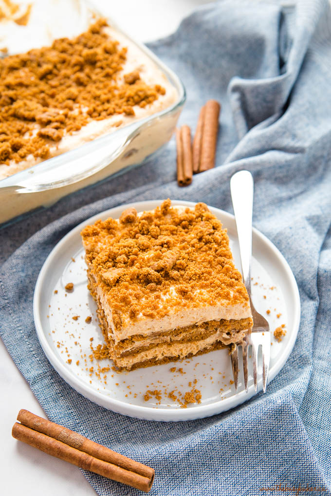 No Bake Pumpkin Gingerbread Icebox Cake with cinnamon sticks and blue plate