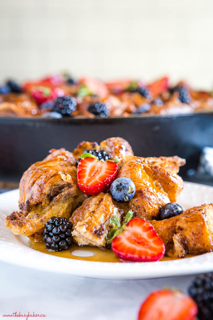 skillet croissant french toast casserole with fresh berries and maple syrup