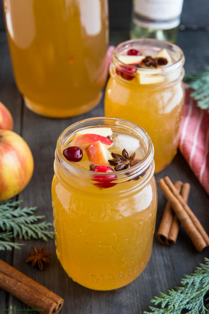 apple cider sangria in mason jar with apples and cranberries