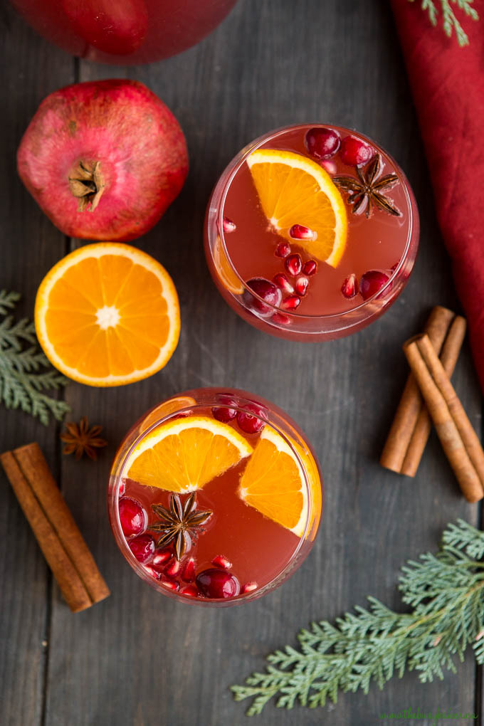 overhead photo: glasses Christmas champagne punch with pomegranate and cranberries