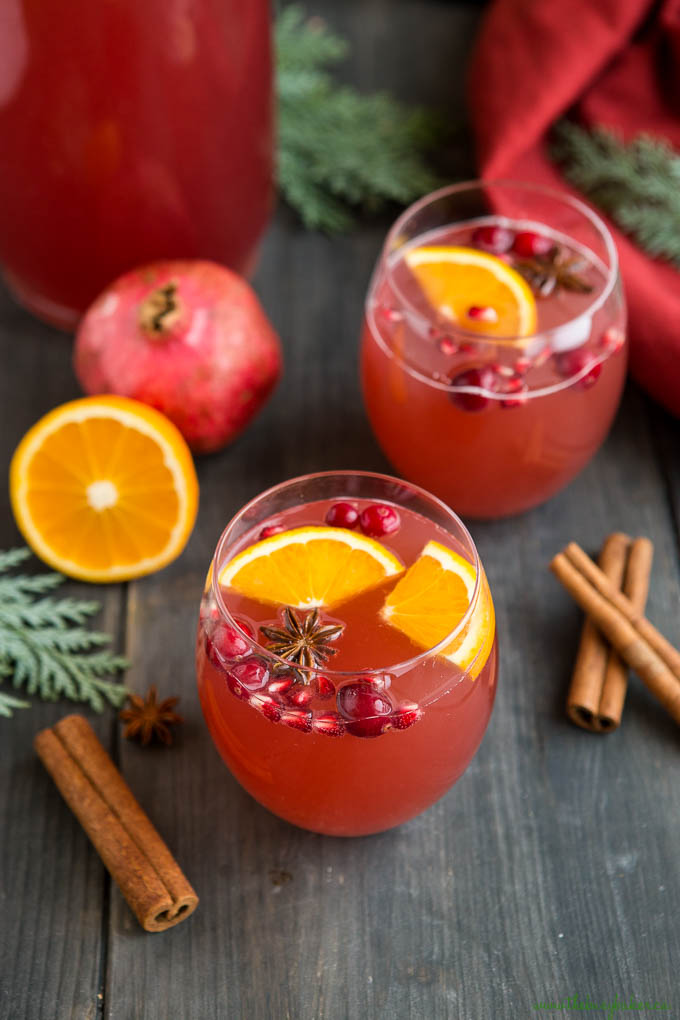 festive red holiday punch in stemless wine glasses