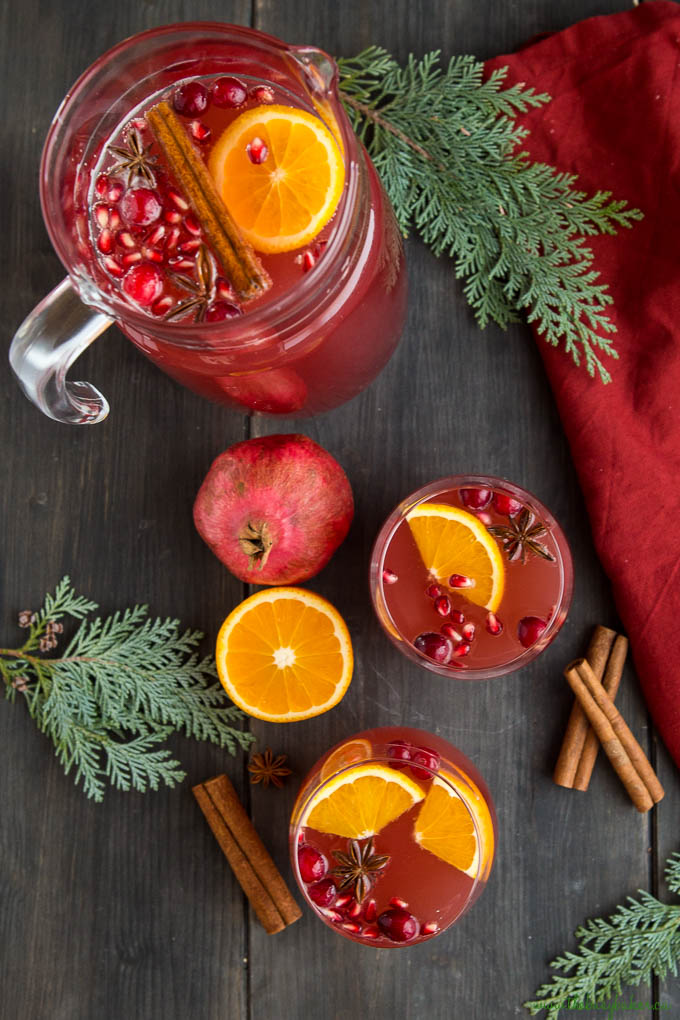 christmas punch in pitcher with orange and pomegranate