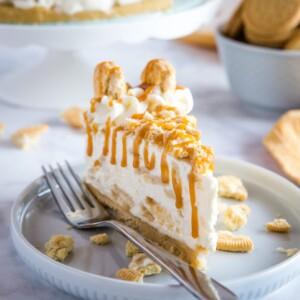 creamy slice of Golden Oreo cheesecake on white plate