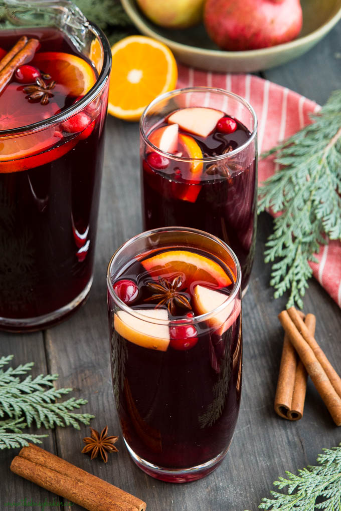 holiday sangria in pitcher with cranberries and cinnamon sticks