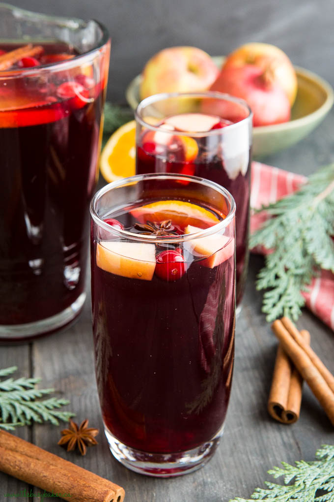 christmas sangria with fruit and cinnamon sticks