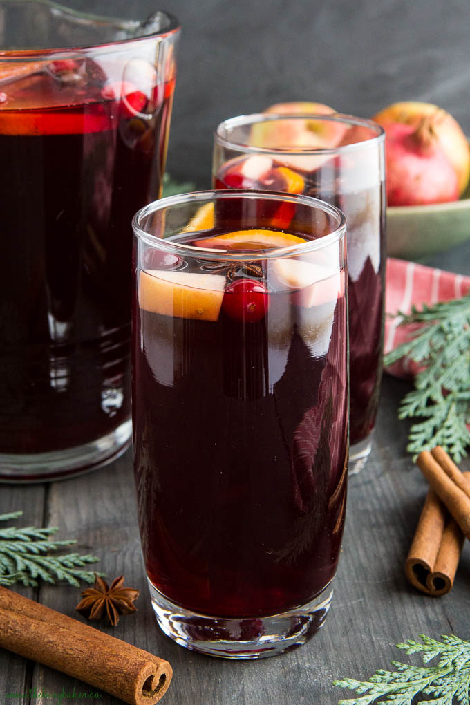 holiday sangria in tall glass with cranberries