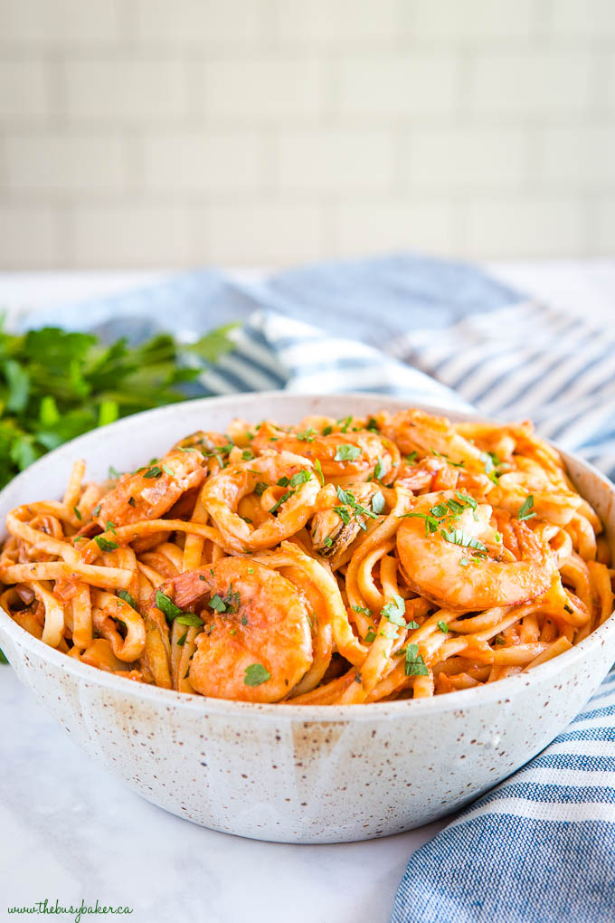 seafood marinara linguine in pottery bowl with shrimp and squid