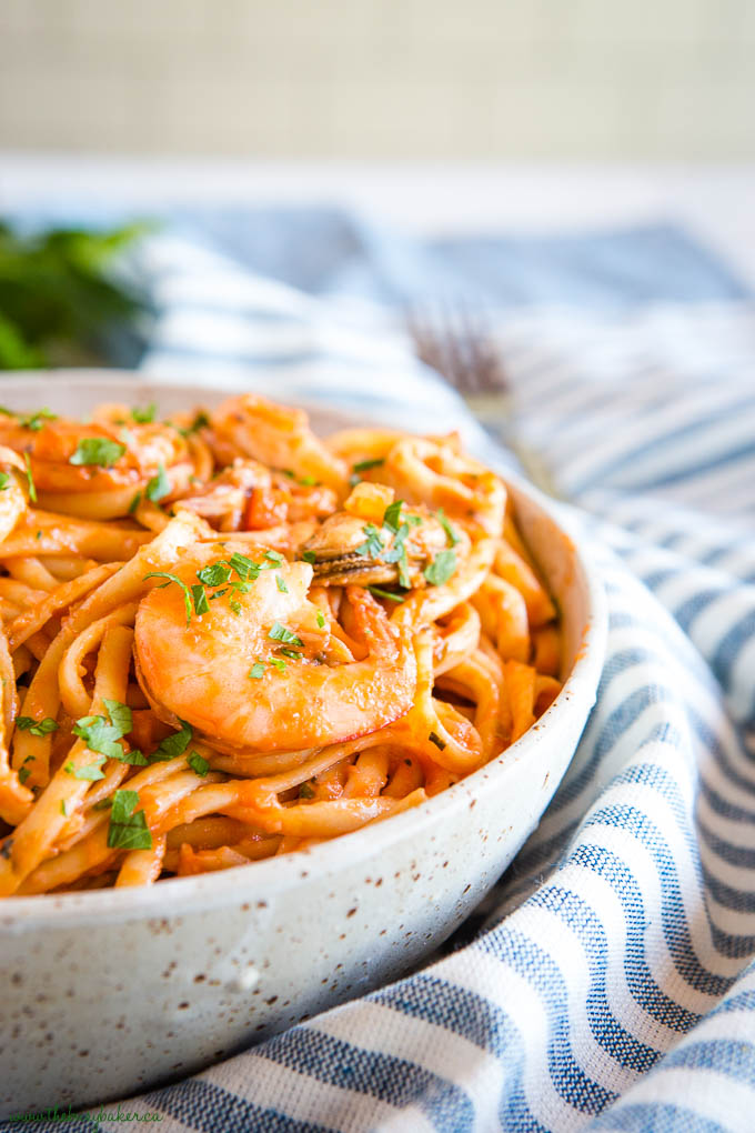 seafood marinara linguine with shrimp in pottery bowl