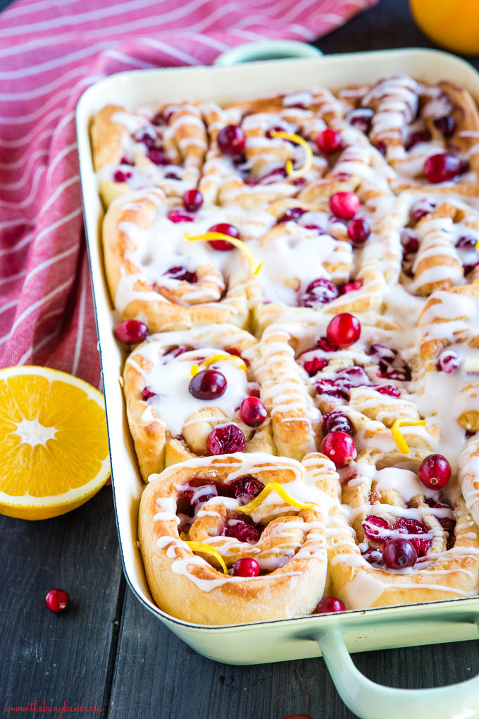 cranberry orange sweet rolls in green pan