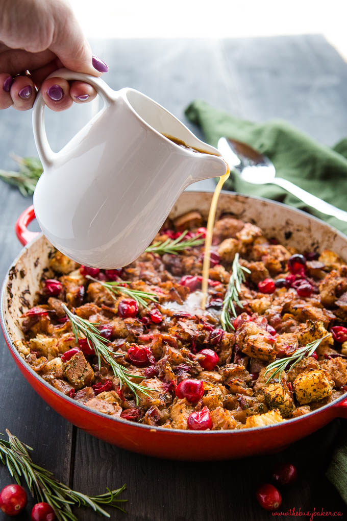 making a quick stuffing recipe in a red pan on a stove top