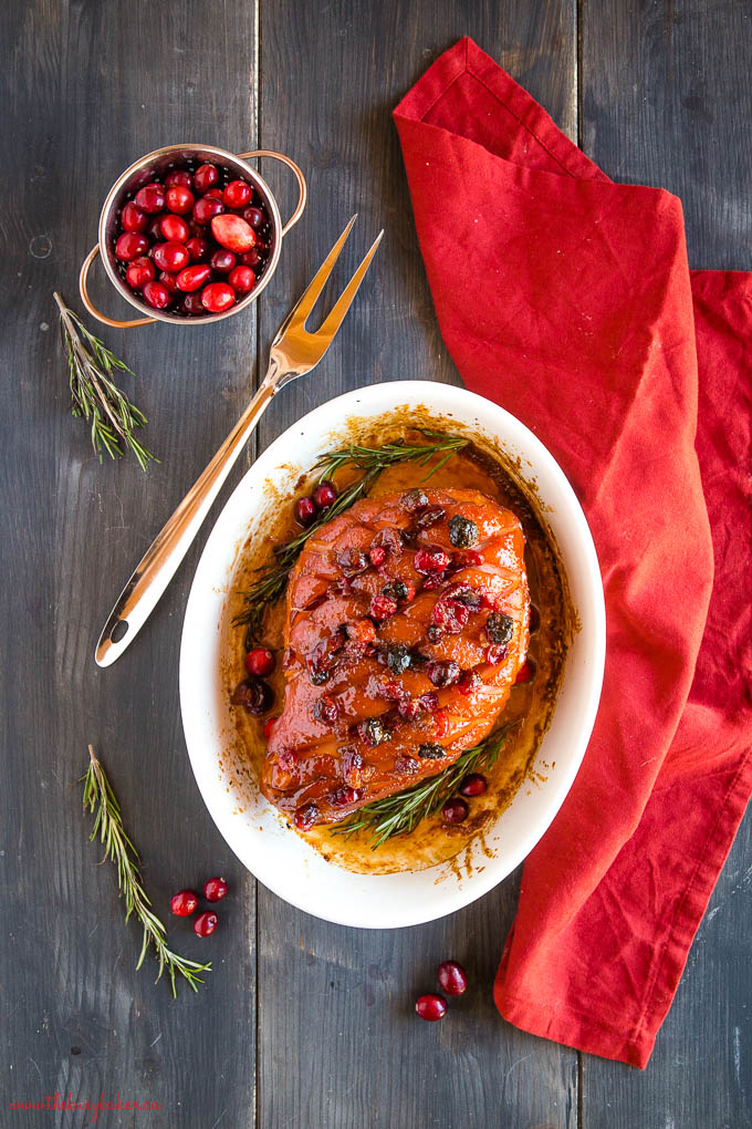 holiday christmas ham with cranberries and rosemary