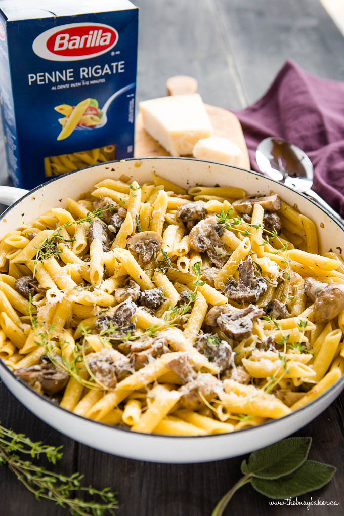 creamy mushroom champagne pasta in white pan with parmesan