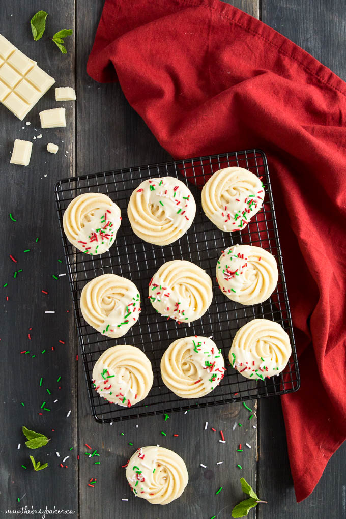 piped shortbread cookies dipped in white chocolate with sprinkles