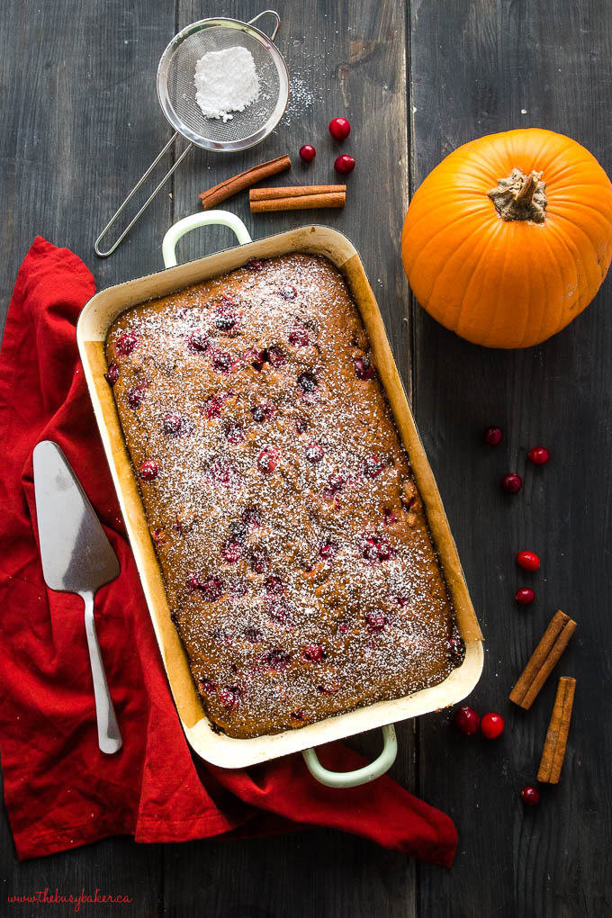 easy pumpkin cranberry cake with cinnamon sticks and powdered sugar