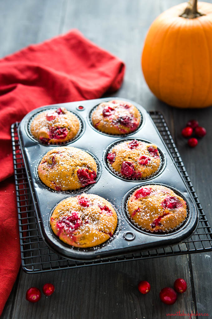 pumpkin cranberry muffins in black muffin tin