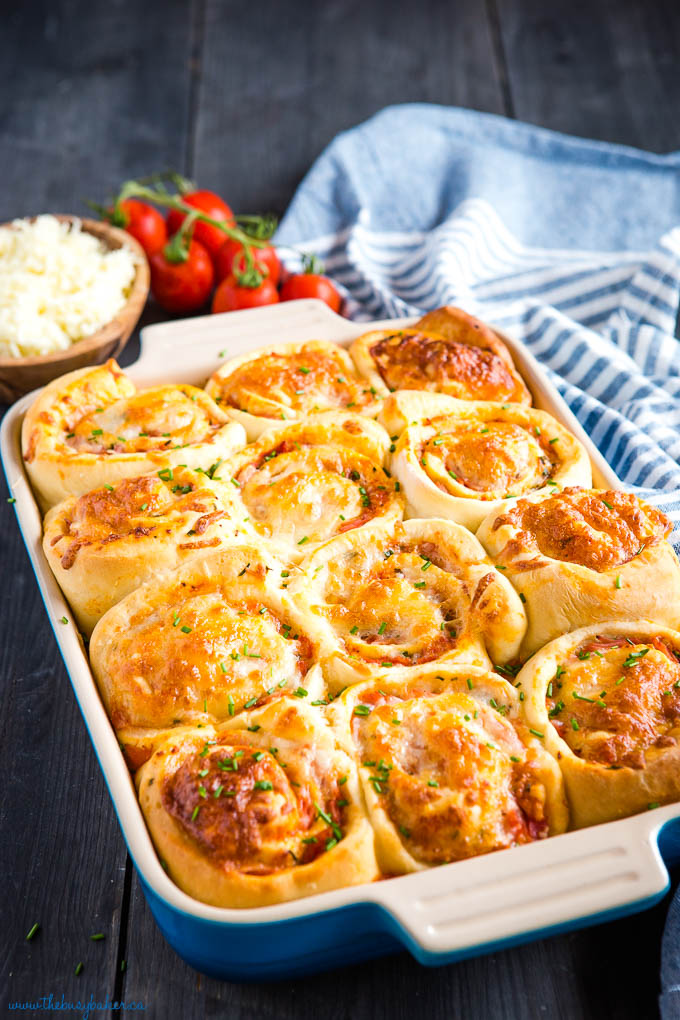 ham and cheese pizza rolls in blue baking pan