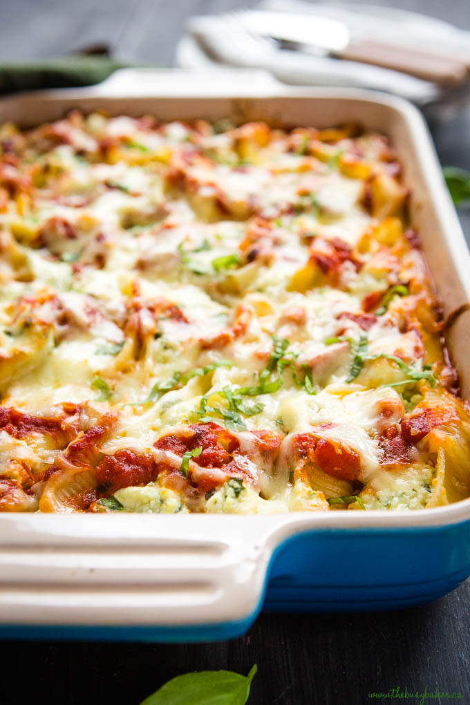 ricotta and spinach stuffed shells in blue casserole dish
