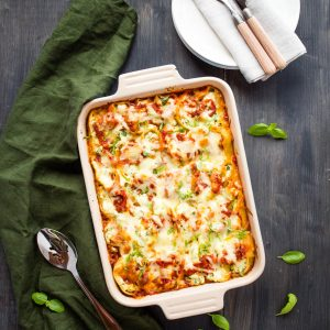 casserole dish of stuffed shells with spinach, ricotta cheese, and fresh