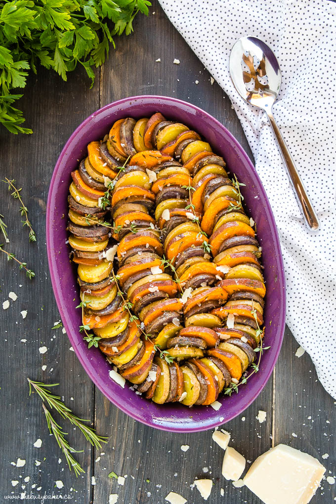 sweet potato and purple potato casserole in purple dish