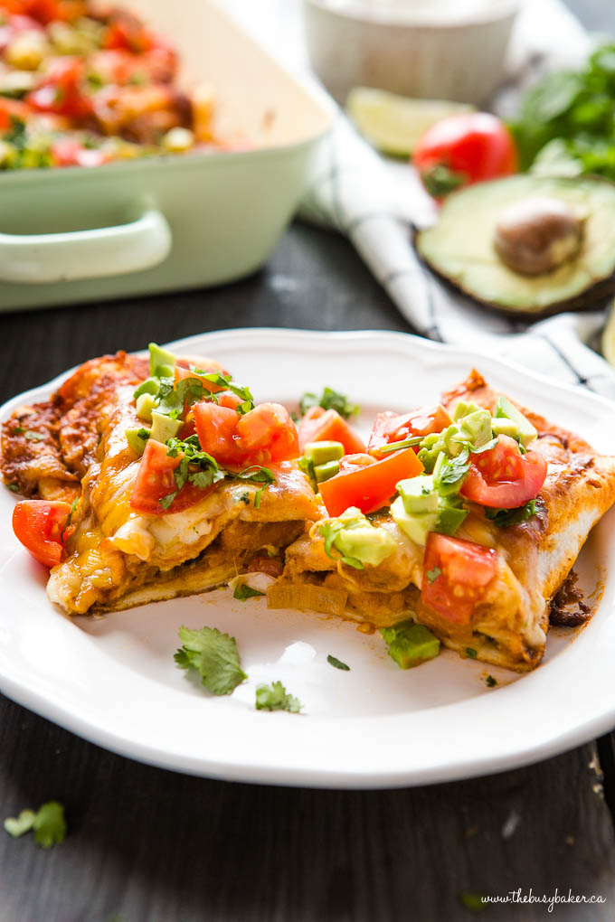 Sweet Potato Black Bean Enchiladas cut in half on white dinner plate