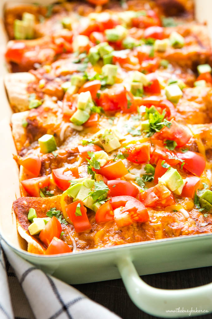 Vegetarian enchiladas in green casserole dish